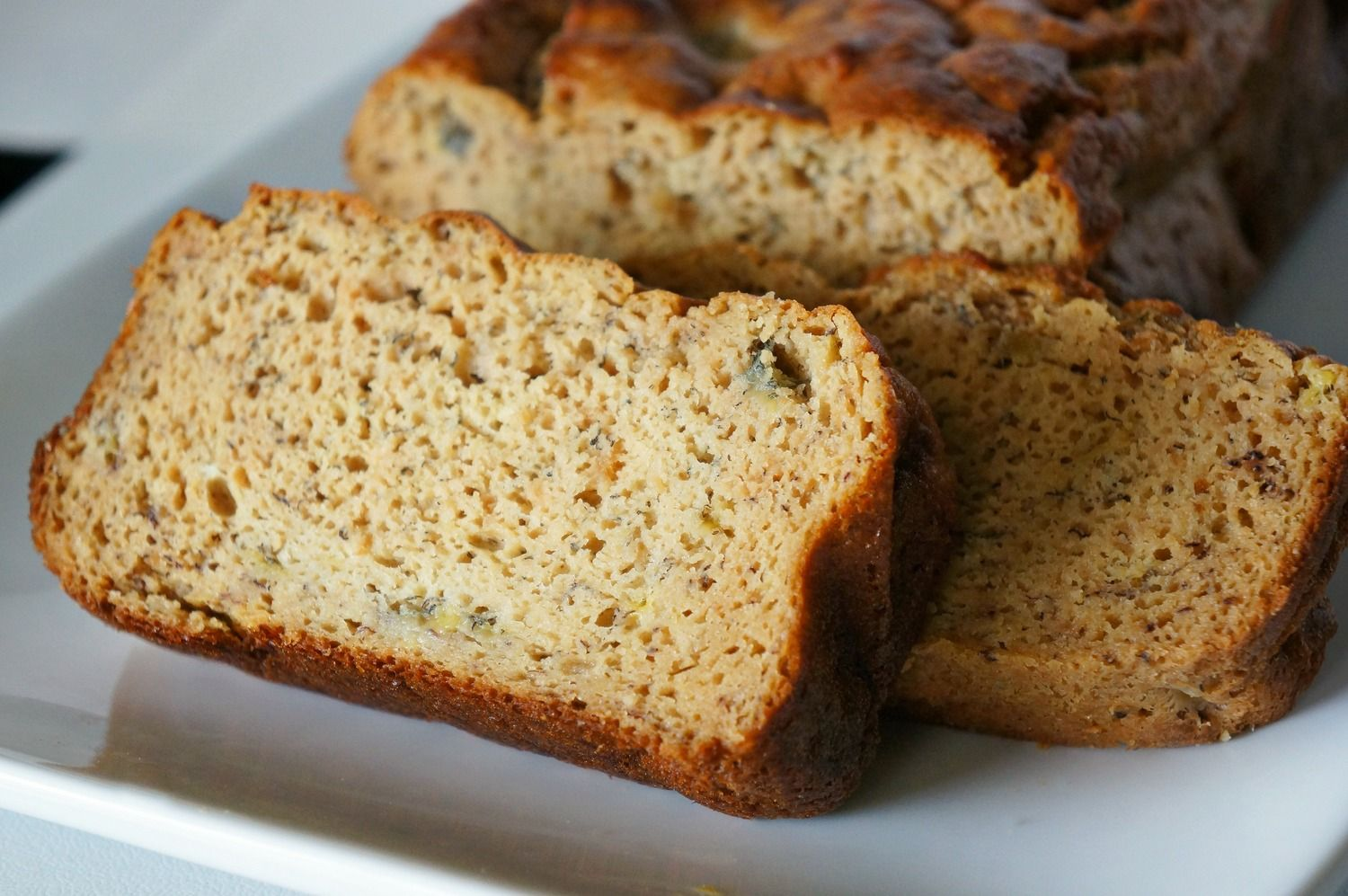 Finally! A moist, no-sugar-added, gluten-free, oil-free, whey protein banana bread!  Banana bread is and always has been one of my favorite baked goods so I HAD to create a healthy version so I won't feel guilty eating 2 or 3 pieces. Or 6.  If you have ever tried baking with whey protein