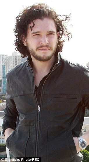 Kit Harington reveals Jon Snow's signature long curly locks are under contract.