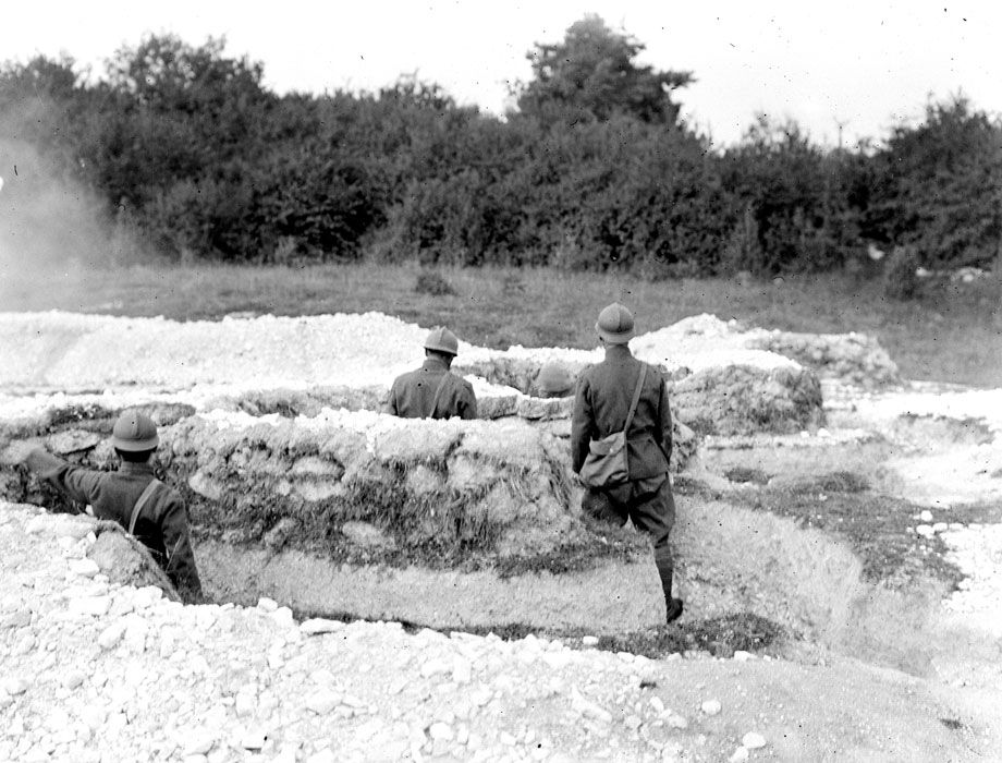 Grenadier du Marche Regiment of the Foreign Legion (RMLE) train at throwing hand grenades at Dampierre camp. July 1917.