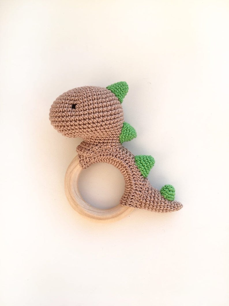 amigurumi toy amigurumi rattle knitted rattle rattle on a wooden toy on a wooden ring dinosaur knitted dinosaur