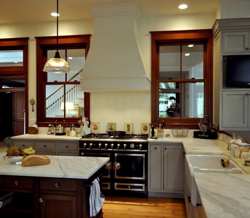 The Stained Wood Trim Stays 16 Wall Colors To Make It Sing Stained Wood Trim Dark Wood Trim Stained Kitchen Cabinets