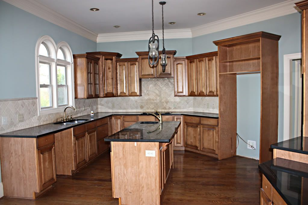 Our current house dark wood kitchens trim work and for White kitchen cabinets with oak trim