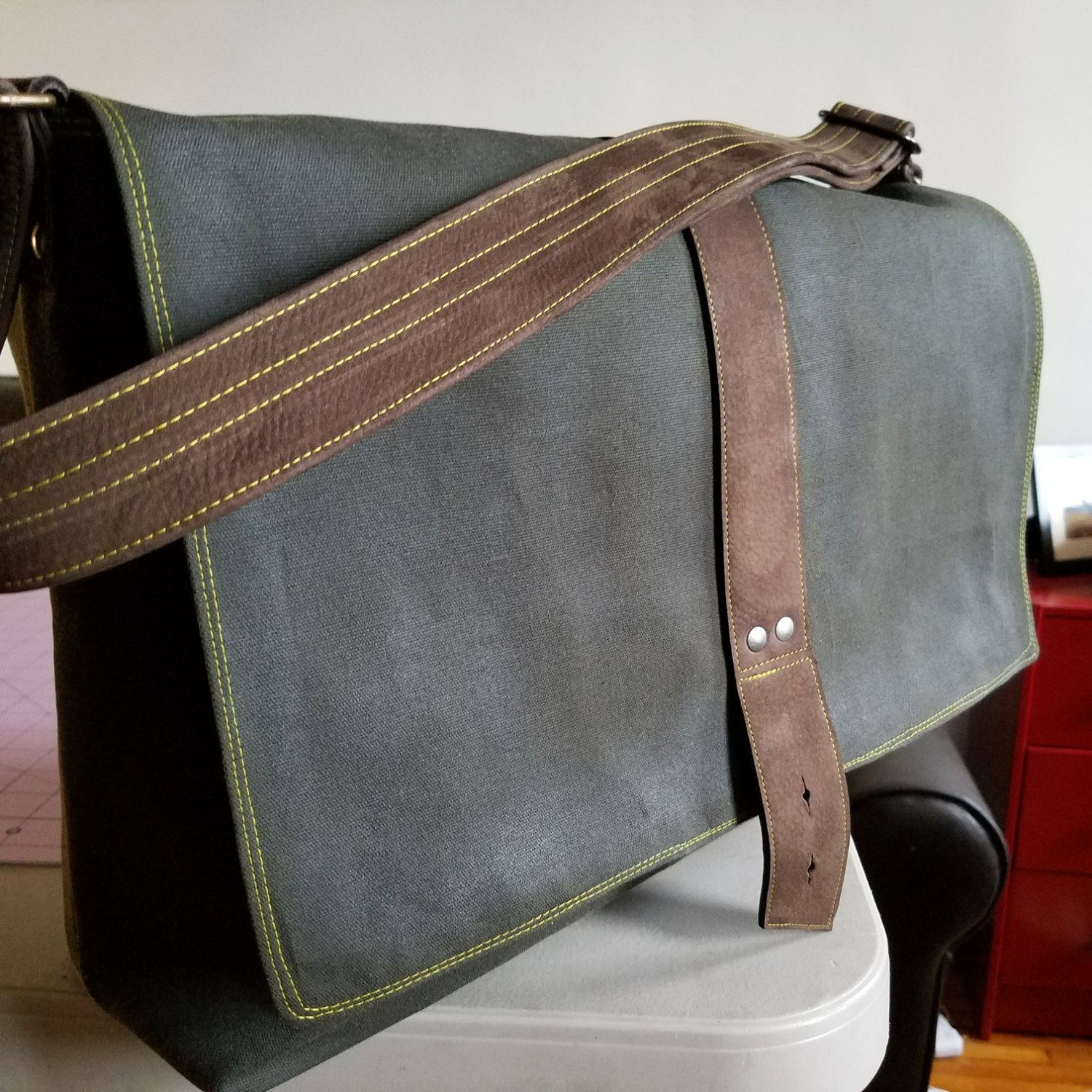 Hunter Green Sloane Messenger Bag with yellow stitching for a more  sporty-casual vibe. ab2fda362e803