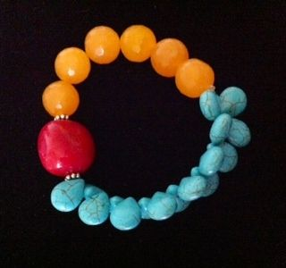 Turquoise with a Twist Stretch Bracelet. Red stone with yellow gold beads and turquoise stones