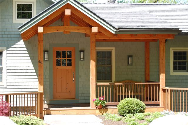 Maintaining the simple cottage fasace common to keuka lake for Small exterior doors
