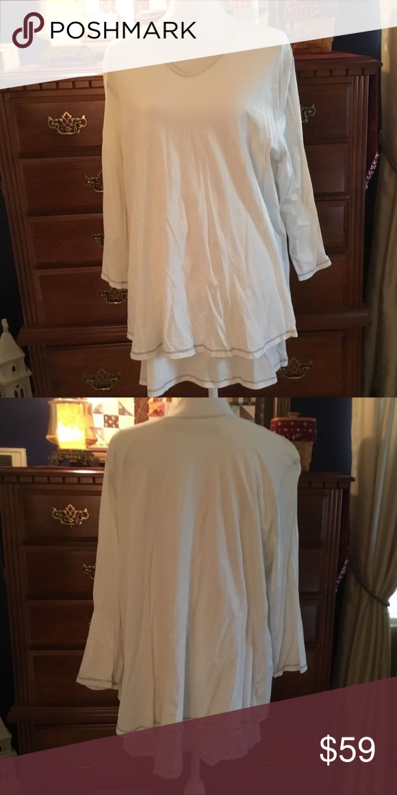 """CYNTHIA ASHBY TUNIC CYNTHIA ASHBY DOUBLE PLY TUNIC. WHITE WITH BLACK STITCHING. 91% COTTON 9% LYCRA. SIZE XL. UNDERARM TO UNDERARM MEASURES 23"""". BOTTOM LAYER IS 31"""" TOP LAYER IS 28"""" MEASURED FROM SHOULDER DOWN. A VERY CUTE PIECE. CYNTHIA ASHBY Tops Tunics"""