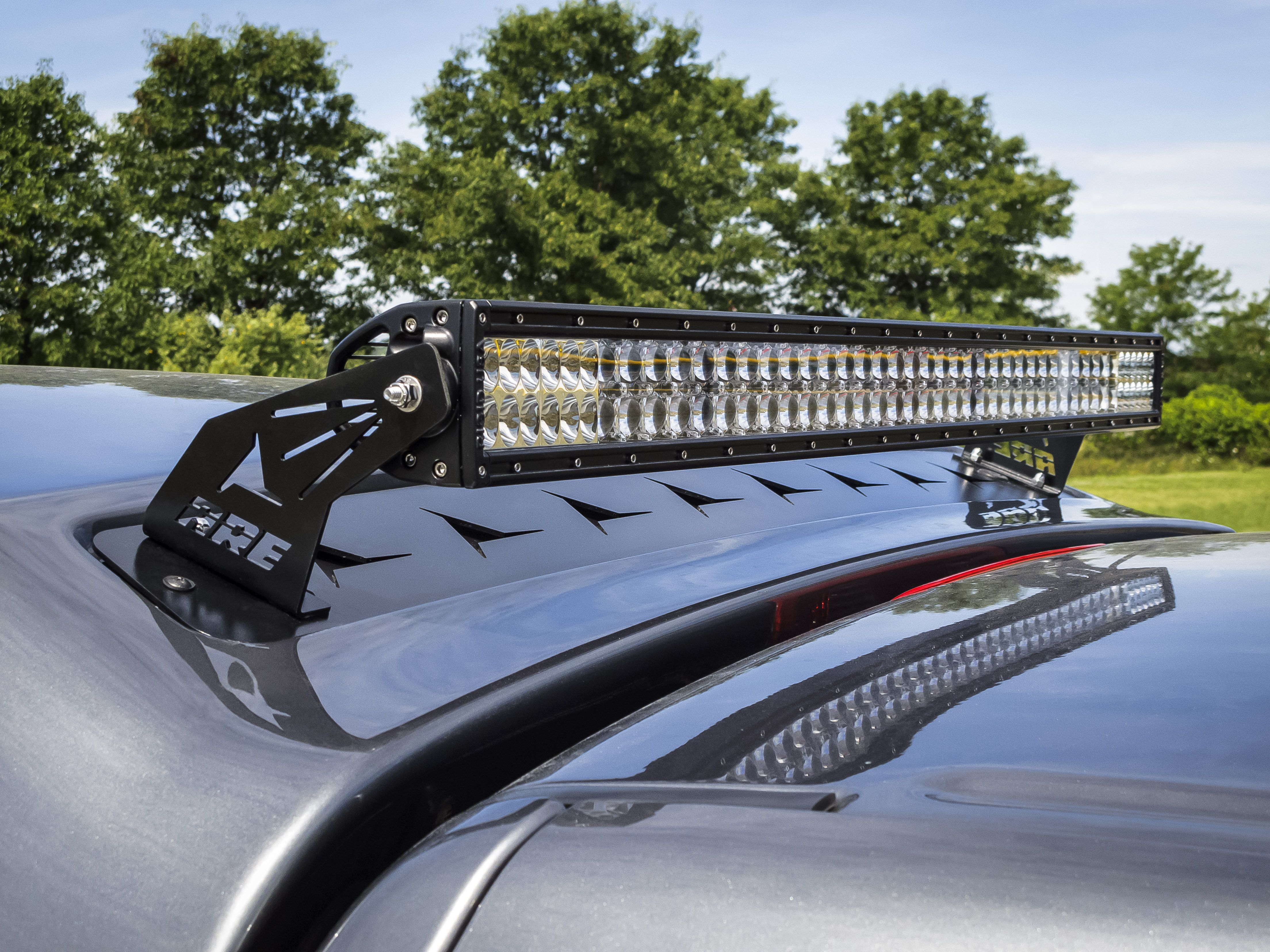 Motorn news are partners with rigid to offer light bars as accessories now offers rigid industries e series led light bars as optional equipment on their fiberglass mx series truck caps which are available for aloadofball Choice Image