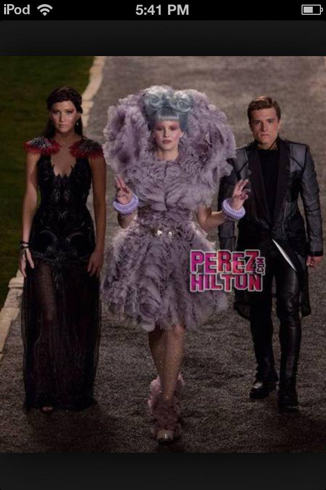 Katniss, Peeta, and Effie are walking to President Snow's ...