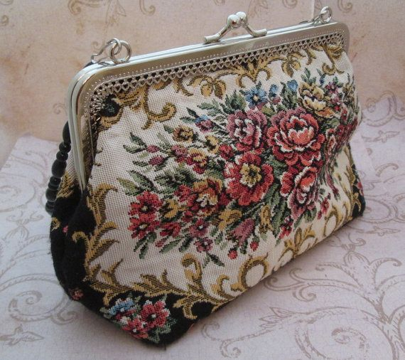 """Tapestry Bag Vintage Carpet Bag Purse 1980s petit point - sweet vintage bag of pretty pink flowers design on medium weight tapestry style fabric .. faux petit point look in a gorgeous pierced metal frame -  zippered inside pocket and smooth lining of cool black cotton blend fabric .. removable black beaded handle, kiss lock closure and hard flat bottom .. lovely!  -  perfectly vintage casual for your everyday and fun for your office groove  -  Size - 9"""" wide x 6"""" tall"""