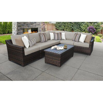 kathy ireland Homes & Gardens by TK Classics River Brook 7 Piece Outdoor Rattan Sectional Seating Group with Cushions | Wayfair