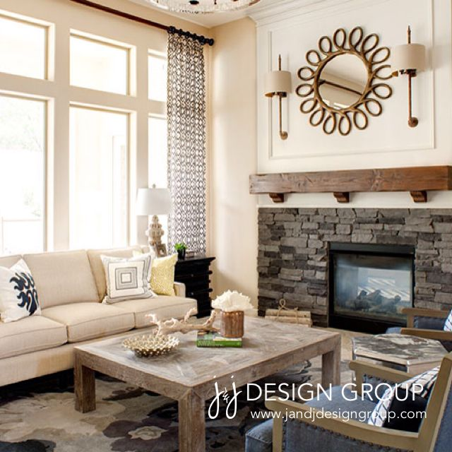 Pretty Living Room #navy #rustic #stone #fireplace #sconces  #jandjdesigngroup