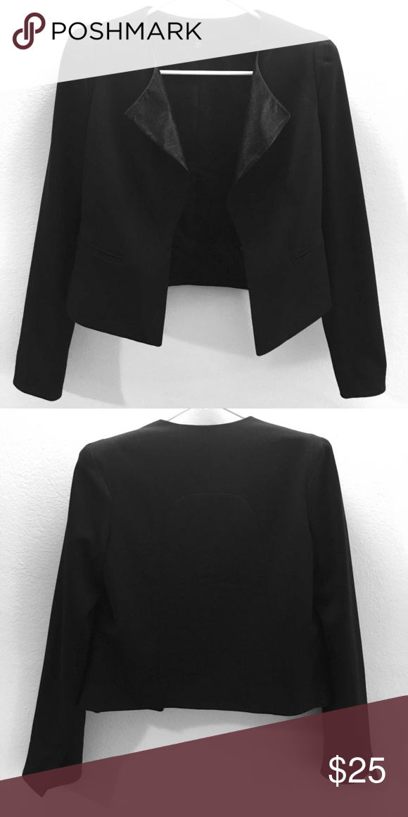Sharp black blazer - GAP Wardrobe essential. Classic black blazer with leather interior detail and slight shoulder pads to add edge and definition. Hangs open, or can be closed with a small clasp at the waist. GAP Jackets & Coats Blazers