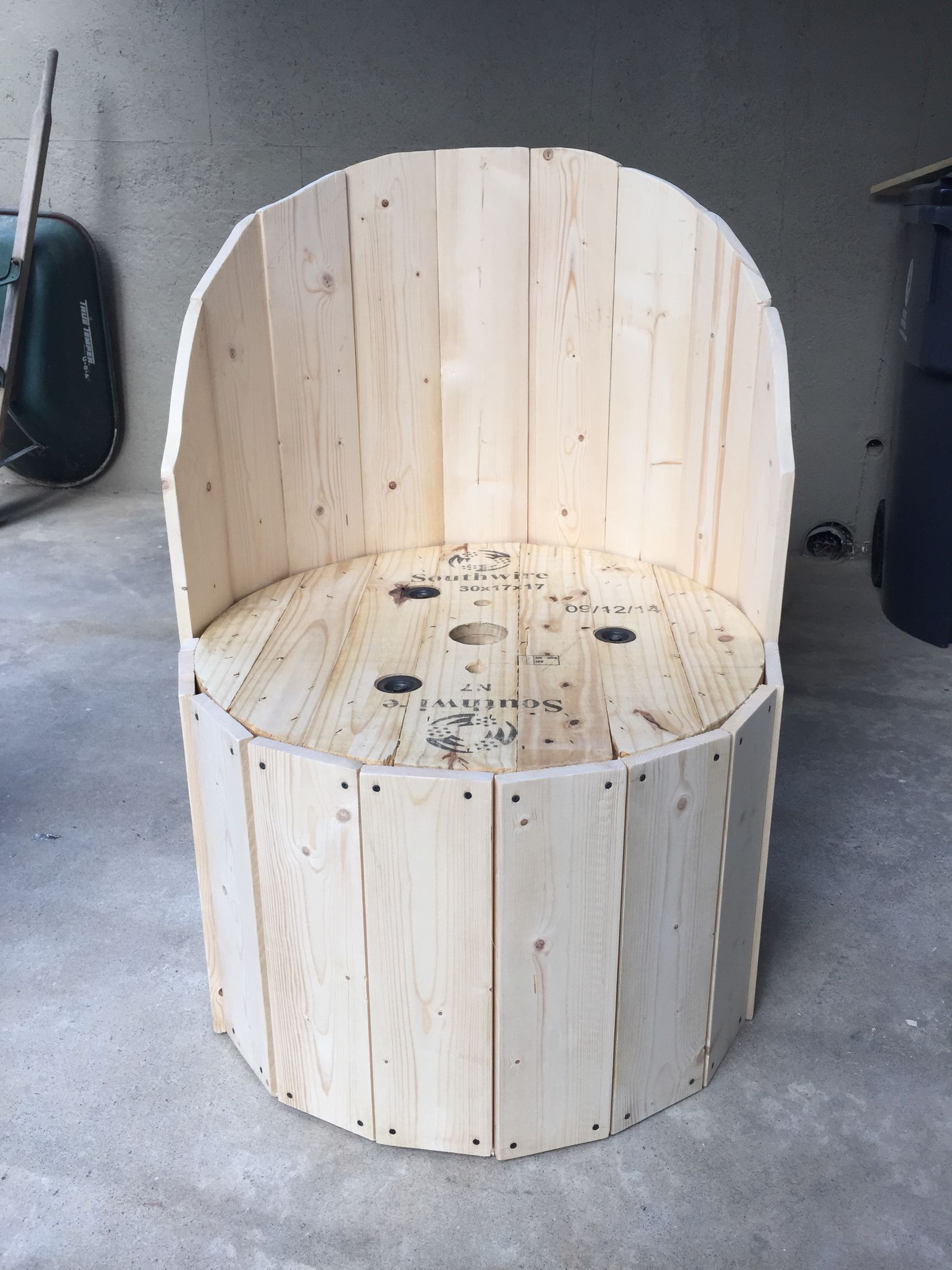 Wire spool made into a chair 1x6 boards Finished all the way