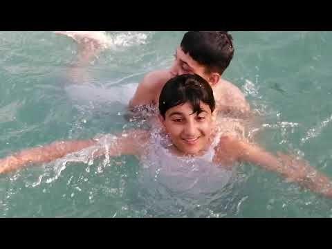 Pakistani boys swimming . Boys are enjoying in fresh water