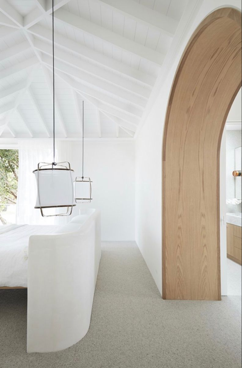 High ceilings and an arched timber feature create