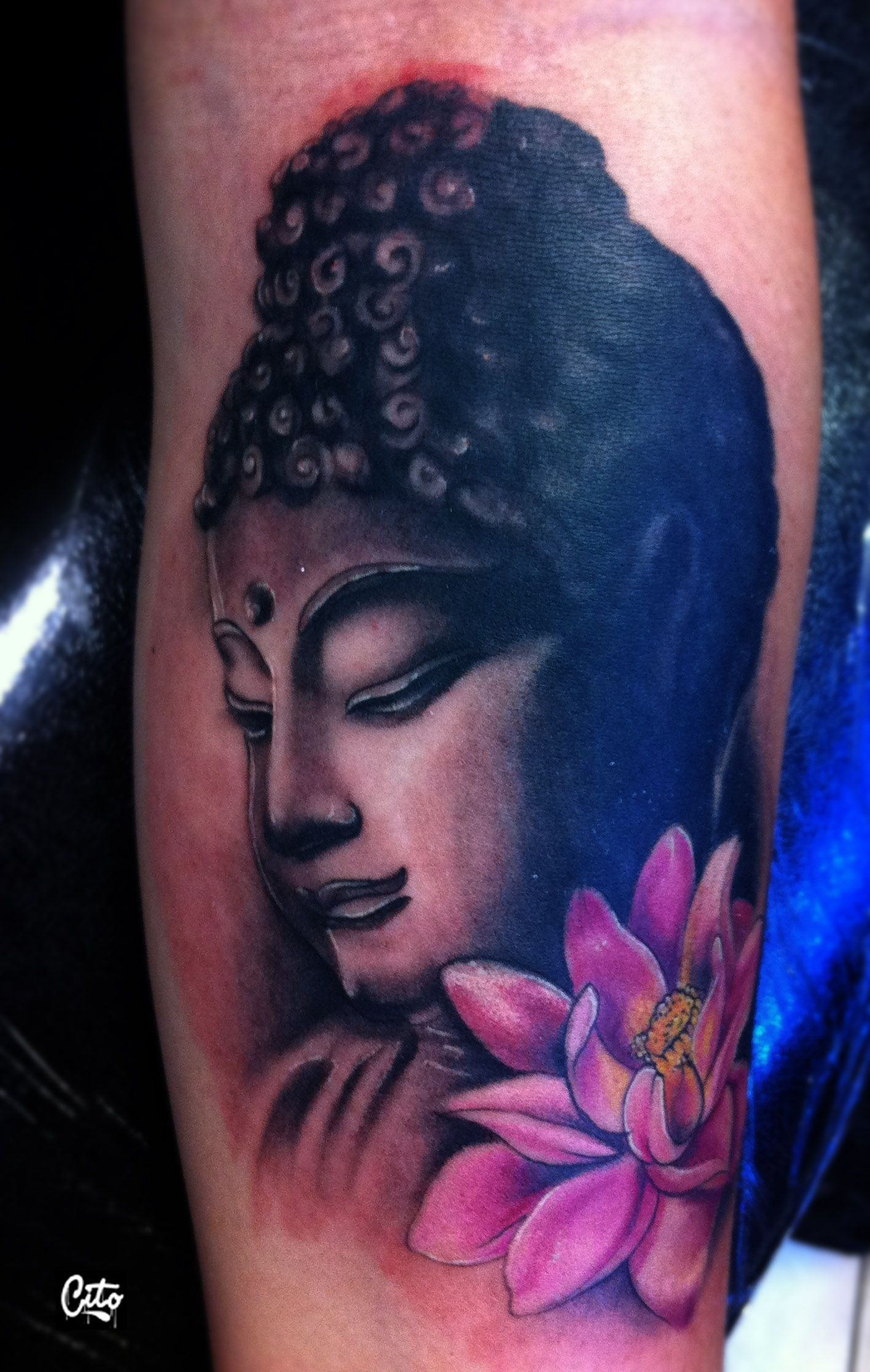 Buddah tattoo /In Buddhism the lotus flower symbolizes faithfulness.  Lotuses are symbols of purity, enlightenment and 'spontaneous' generation and hence symbolize divine birth.