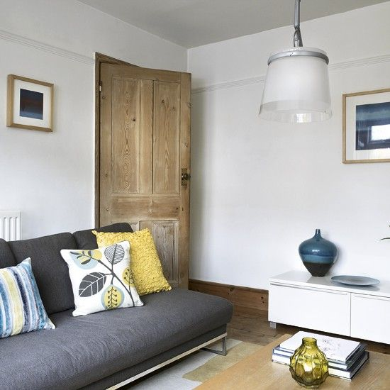 living room designs with grey sofas design ideas for brown couch yellow and blue accents project rear of house cushions housetohome co uk we have a sofa i gloss white side these stripped door looks