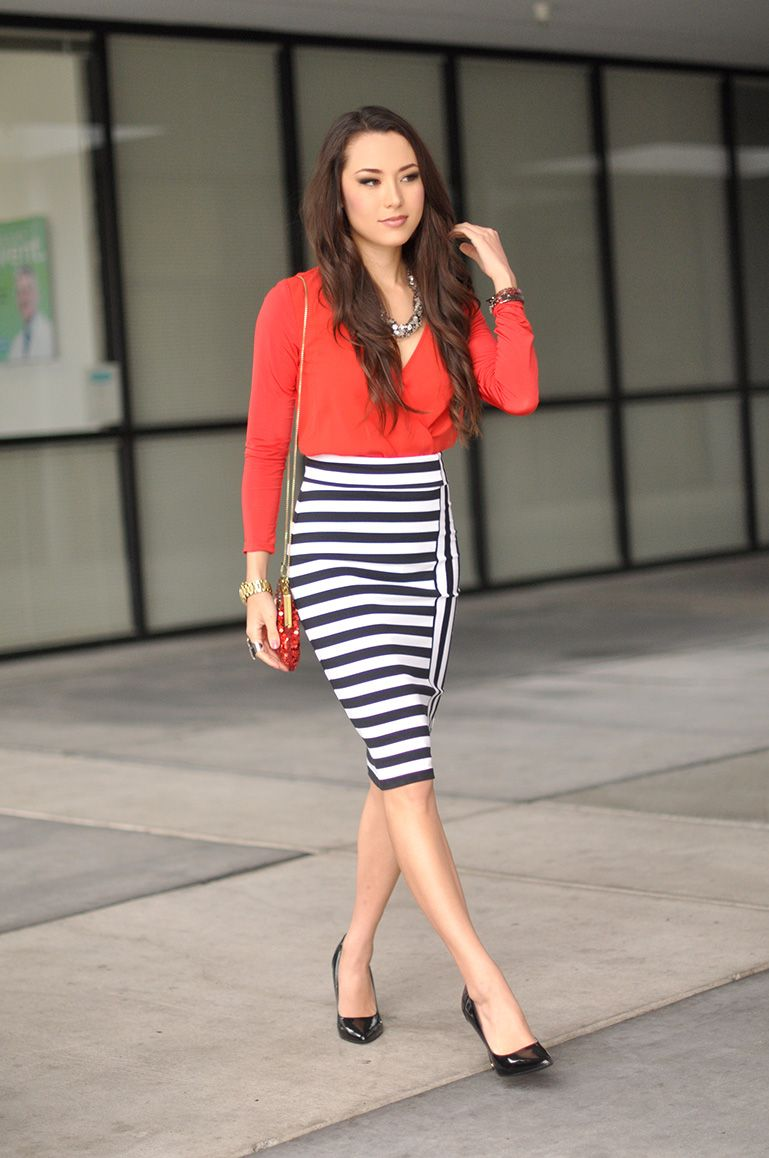 Red top, form fitting black & white striped skirt, black heels and ...