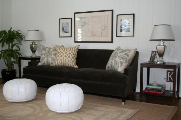 Chocolate Brown Sofa With Light Walls And Beige Carpet Above