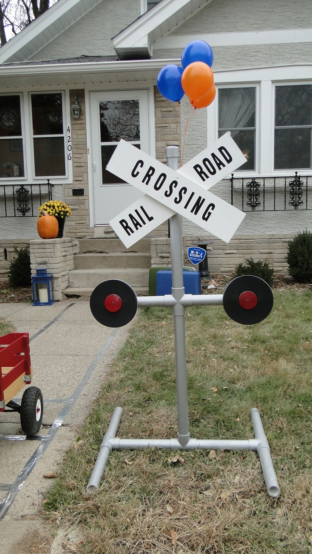 DIY railroad crossing sign made from PVC pipe, plywood