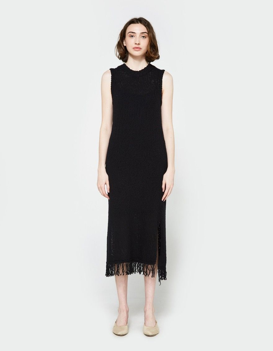 Knit dress from Callahan in Black. Nubby cotton rib knit. Crew neckline. Sleeveless design. Straight through the body. Side slits. Fringe detail at hem. Slim fit. Detached slip included.  • Cotton knit • 100% cotton • Hand wash cold, dry flat
