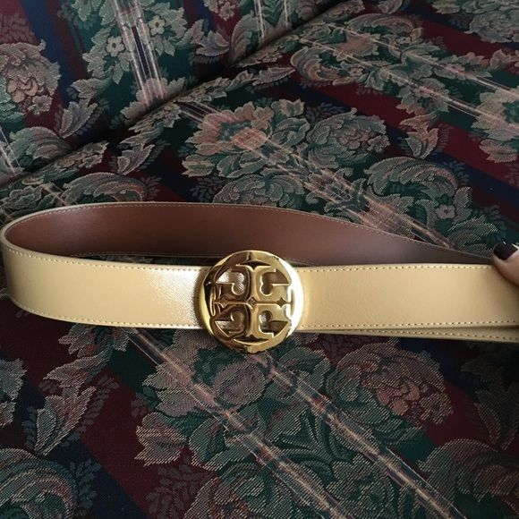142cd84a88b8 Tory Burch logo belt Worn once. This is the larger logo belt. Says in  description reversible. Great neutral color! Tory Burch Accessories Belts