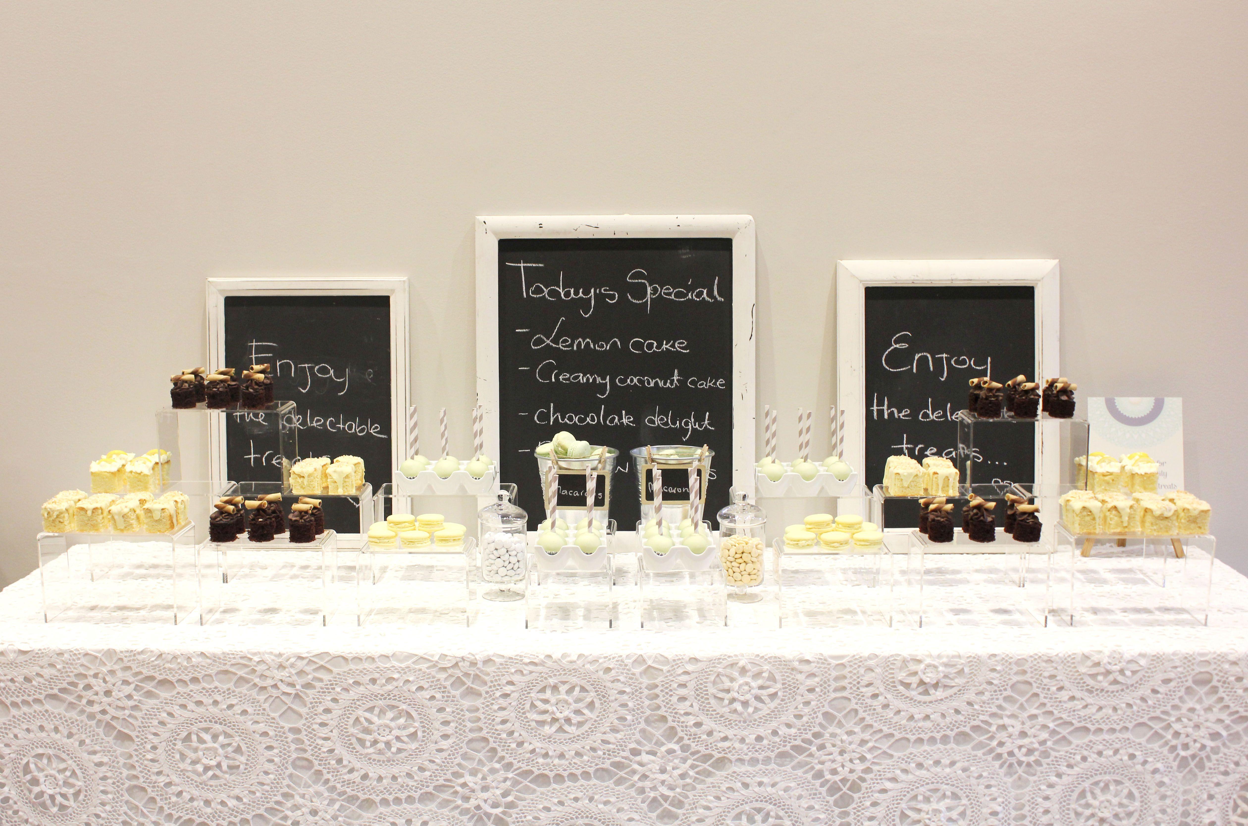 Lemon, mint and chocolate dessert table; lovin' the acrylic risers!