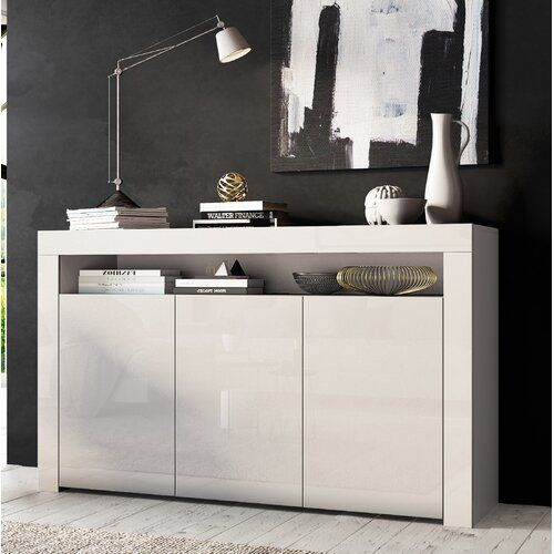 Ebern Designs The doors perfectly complement its elegance. This sideboard has two very spacious compartments behind the doors, with two shelves inside. This sleek and stylish sideboard will look amazing in any living room. Colour: White