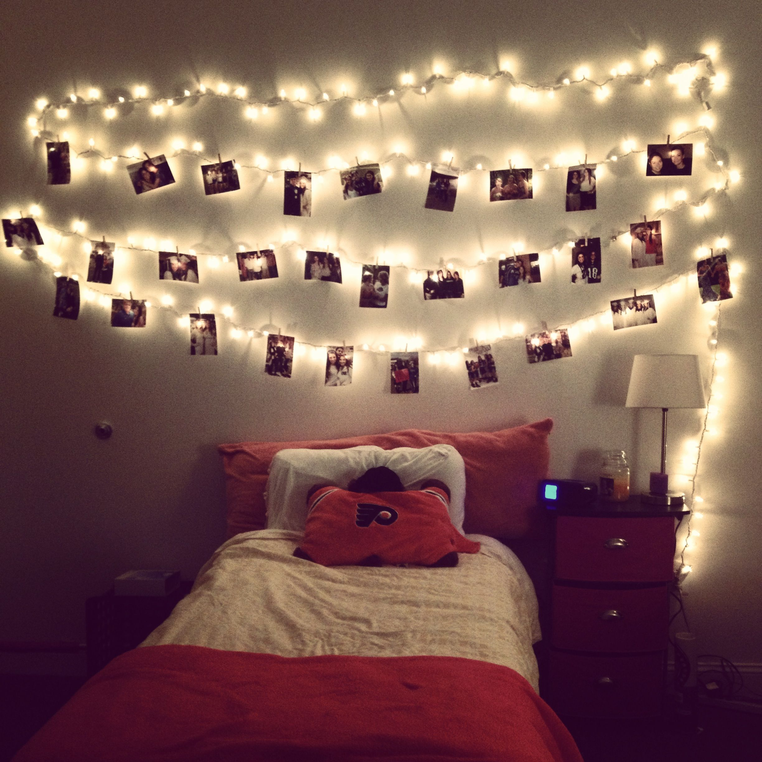 Hang lights and cute pictures with clothes pins, love this instead ...