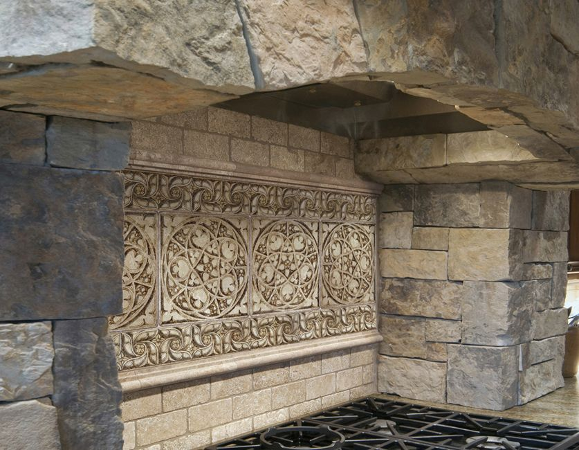 Terrific natural stone tile kitchen backsplash with black iron kitchen stove top also river Stone backsplash tile
