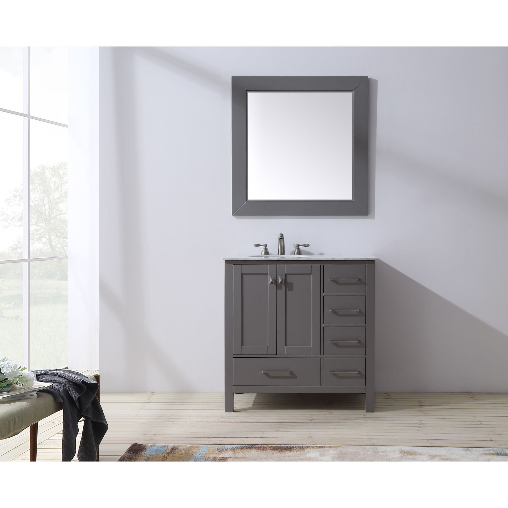 An ideal complement to a contemporary decor, the 36 inch Malibu Single Sink Vanity embodies the clean edges and sophistication of modern design. The rich grey cabinet, made of solid oak lends a warm f...