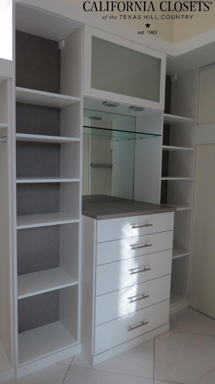 sneak peek of a master closet we designed for silverton custom homes