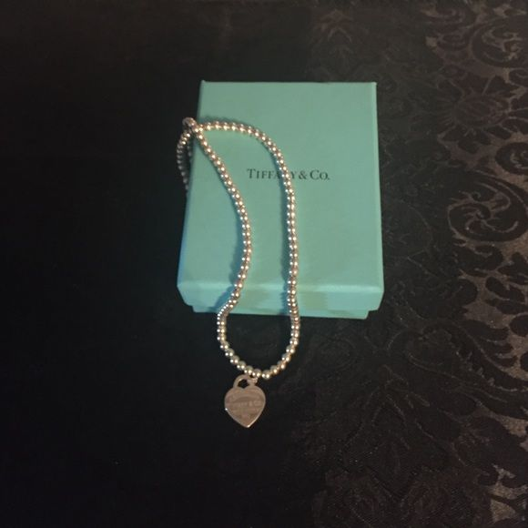 Tiffany & Co Heart Necklace Beautiful necklace! Still in good condition,barely any scratches, comes with box and bag! Still in stores :) Tiffany & Co. Jewelry Necklaces