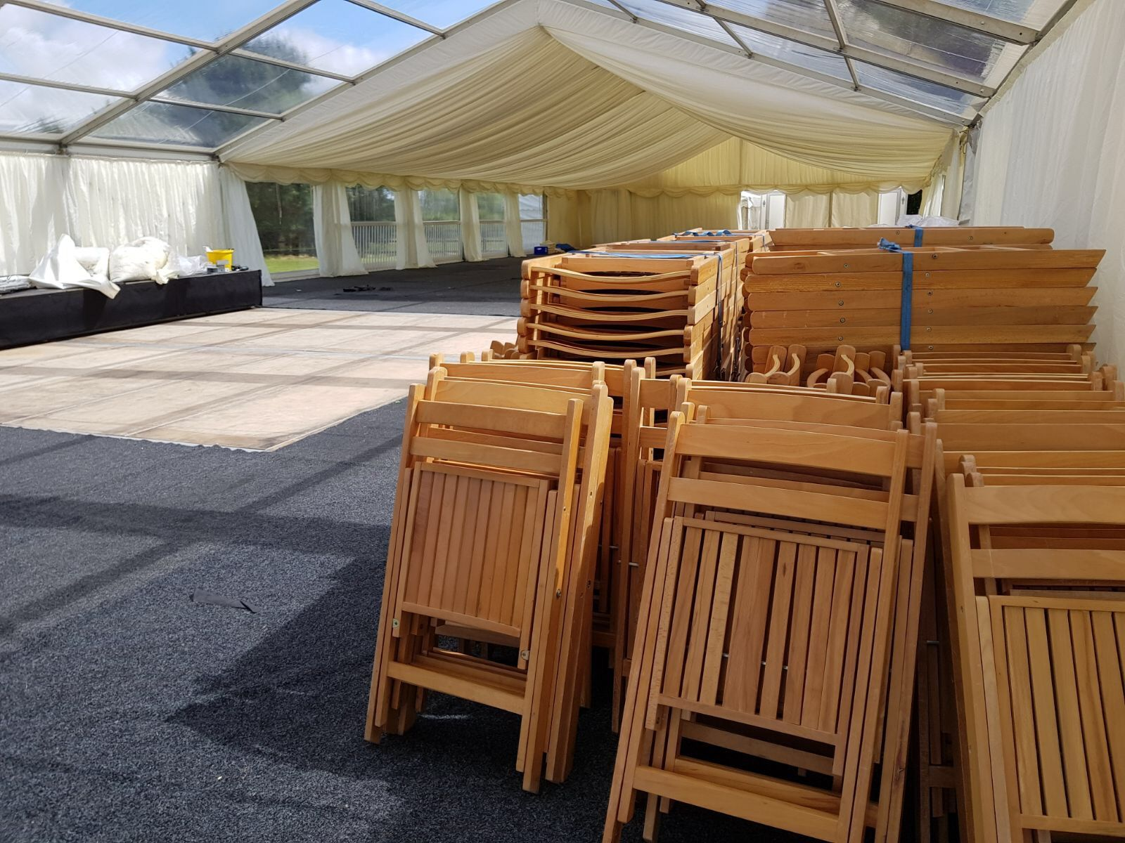 Our Folding Wooden Chairs were basked in sunlight in this summery