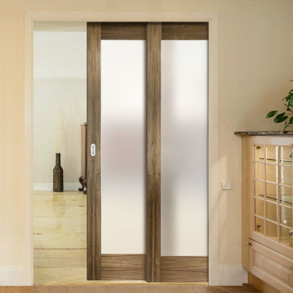 Twin Telescopic Pocket Porto Glazed Walnut Veneer Doors - Frosted Glass - Prefinished.      #pocketdoor  #interiordesign  #oakdoor  #telescopicdoors