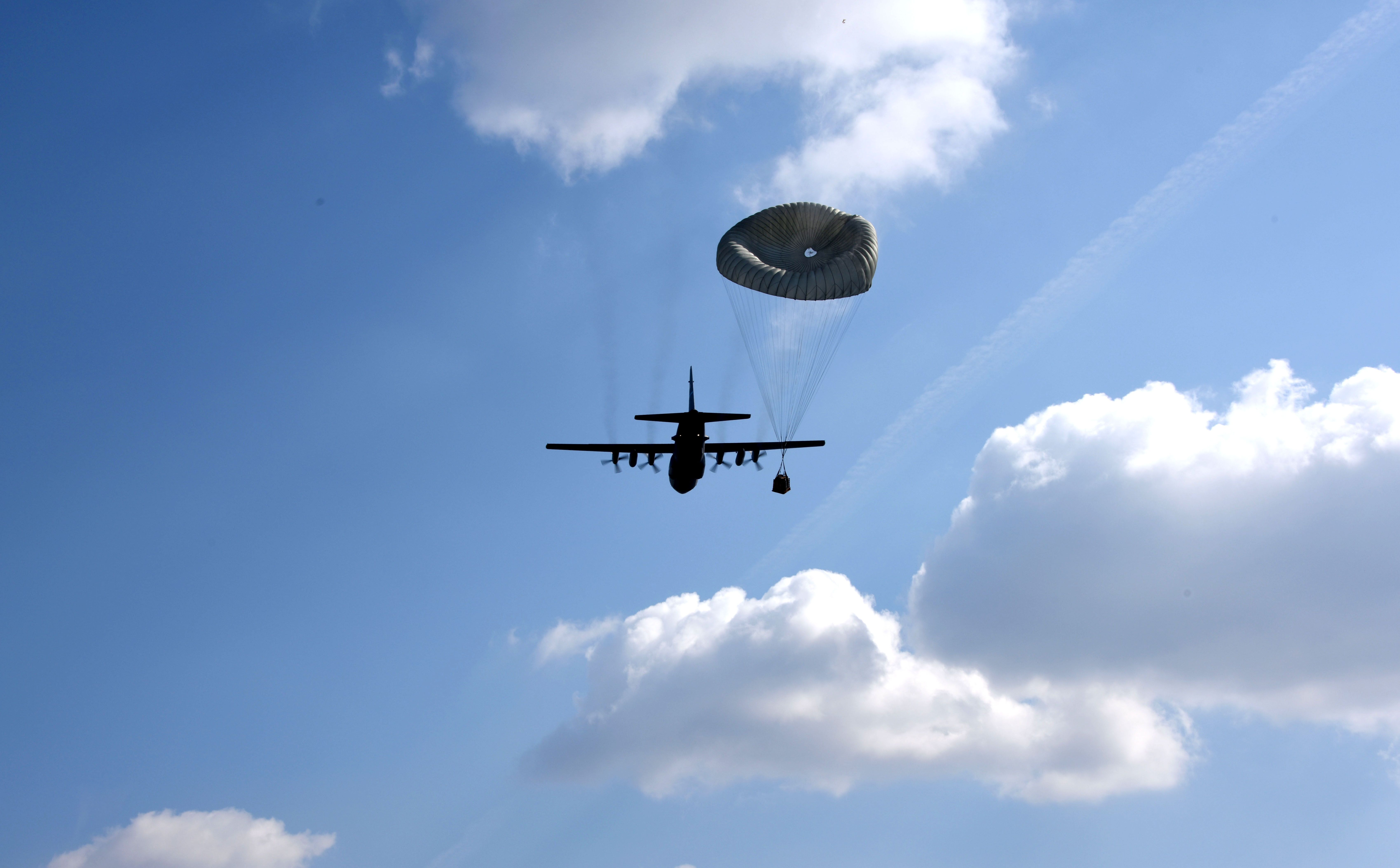 A U.S. C-130 Hercules aircraft conducts an airdrop at Powidz Air Base, Poland, March 24, 2017. Airmen from the U.S. and Poland participated in bilateral training during Aviation Detachment 17-2 in support of Operation Atlantic Resolve. These bilateral trainings focused on maintaining joint readiness while building interoperability. (Air National Guard photo by Staff Sgt. Alonzo Chapman/Released).