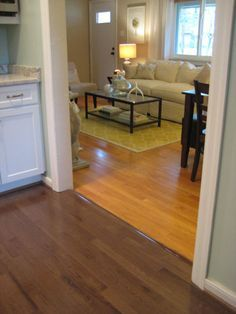 dark brown (no yellow) wood floor: hmmmm. same oak flooring but  stained/finished two different colors in different rooms -