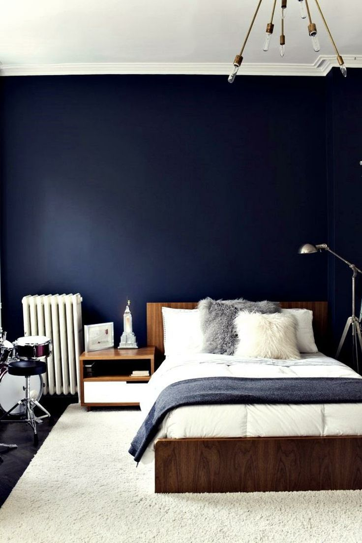 Dark blue feature wall for a dramatic bedroom