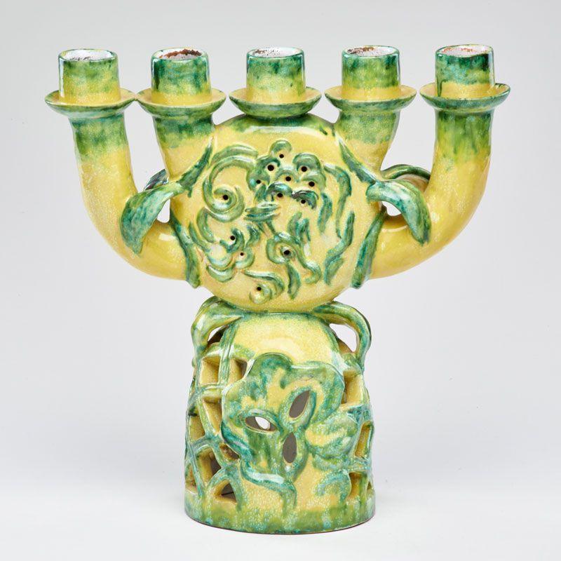 """Lot 1059 - VALLY WIESELTHIER; WIENER WERKSTATTE - Estimate: $700 - $900 - Ceramic five-light candelabra with embossed decoration and pierced base, Austria Impressed Werkstatte stamp 11 1/2"""" x 11"""" x 4 1/2"""""""