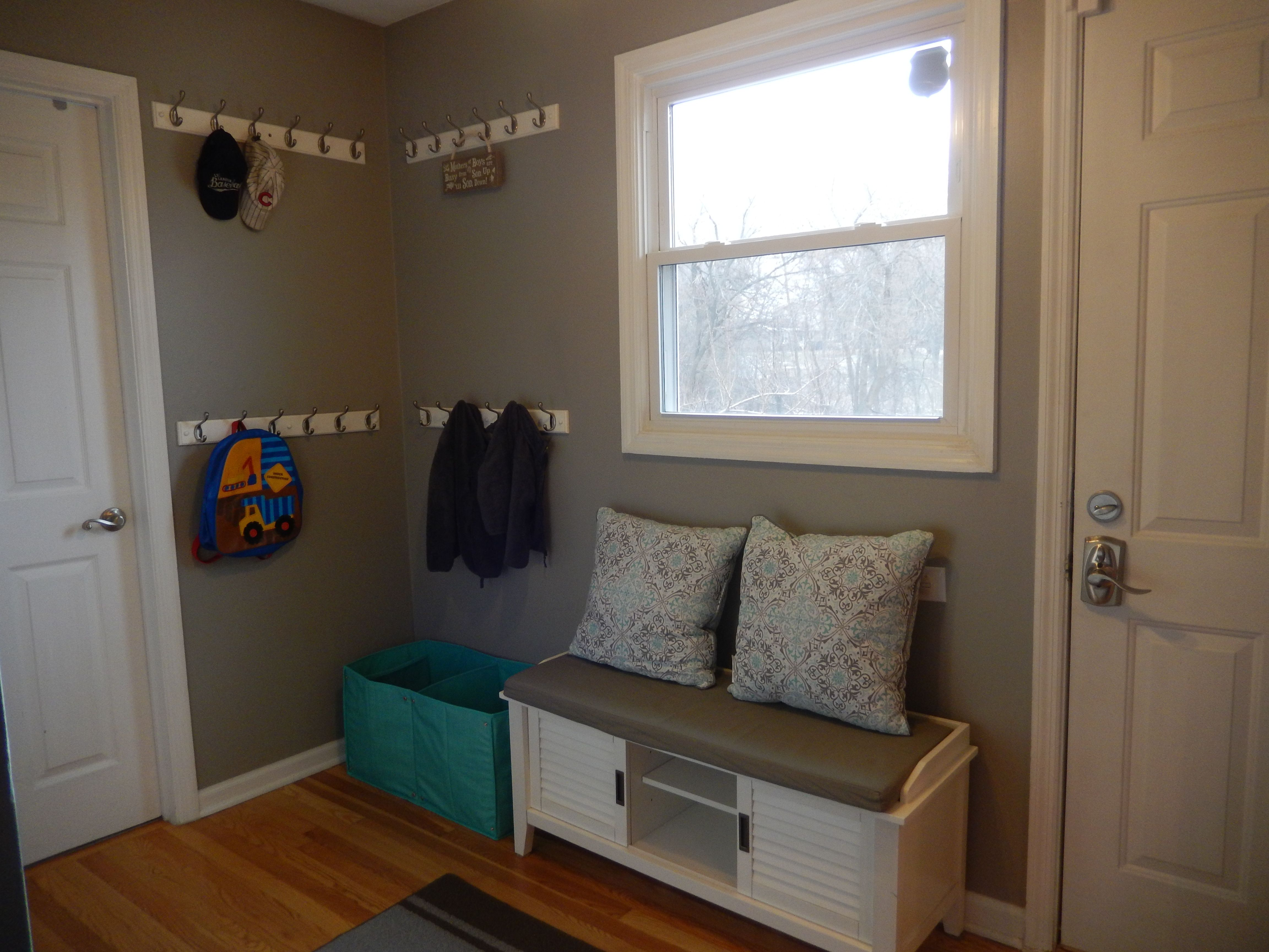 Mudroom with bench grat walls plenty of hooks for backpacks and