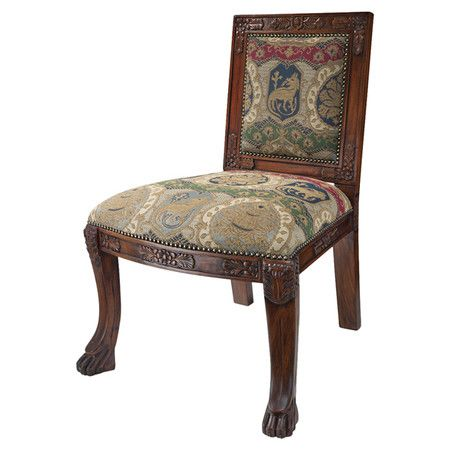 Handcrafted mahogany accent chair with nailhead trim and a heraldic lion motif.  Product: ChairConstruction Material: