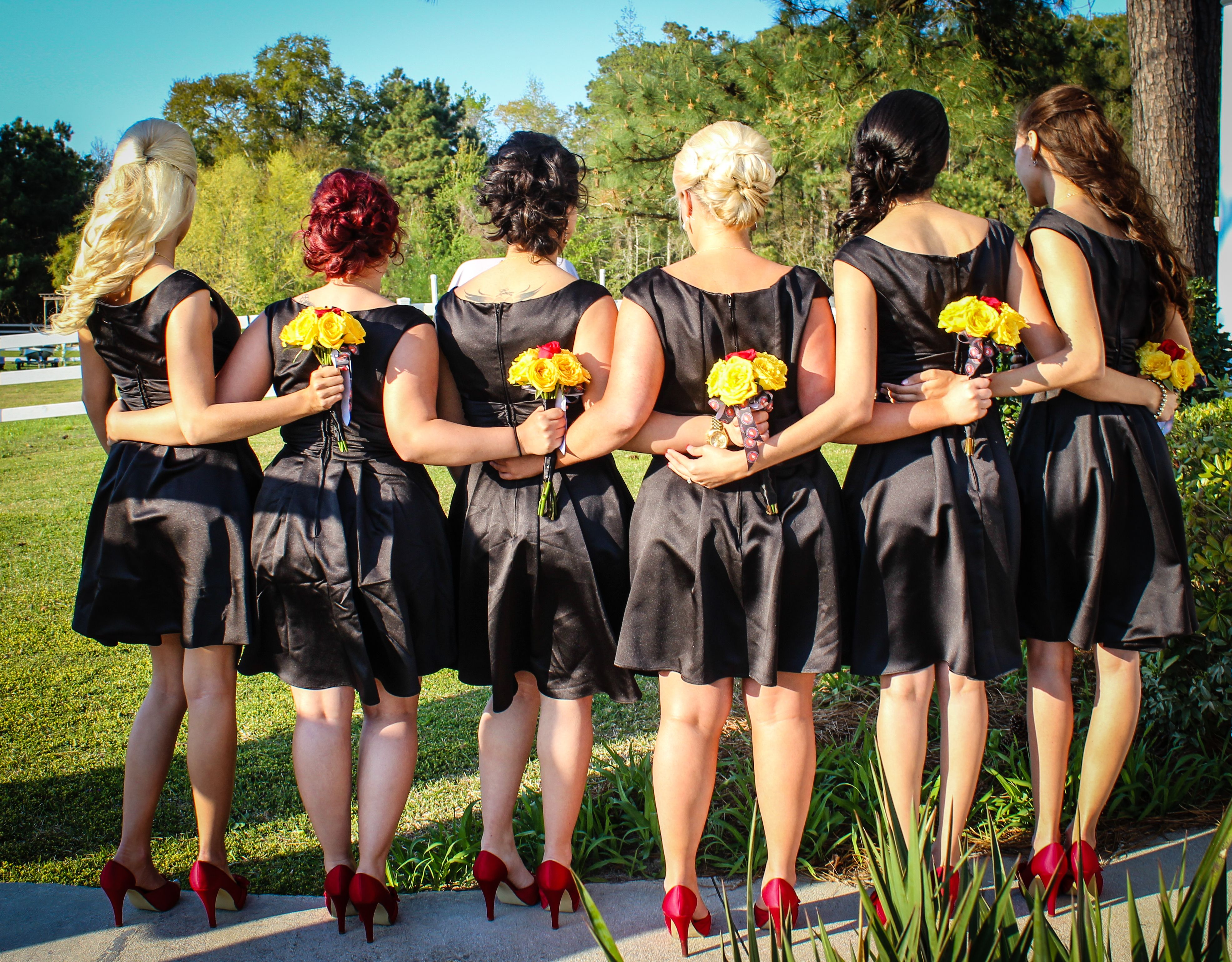 All of the brides maids wore black dresses with red shoes and gold
