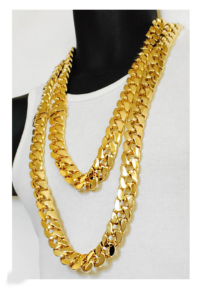 e2f3f4e9d7b73 This Yellow Gold Miami Cuban Link Curb Chain is presented in 14K ...