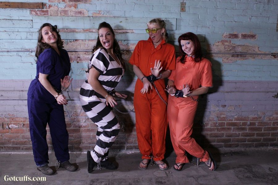 Four Women Obviously Have A Lot Of Fun Wearing Handcuffs