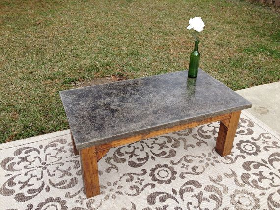 outdoor concrete coffee table. I like the treatment on the concrete