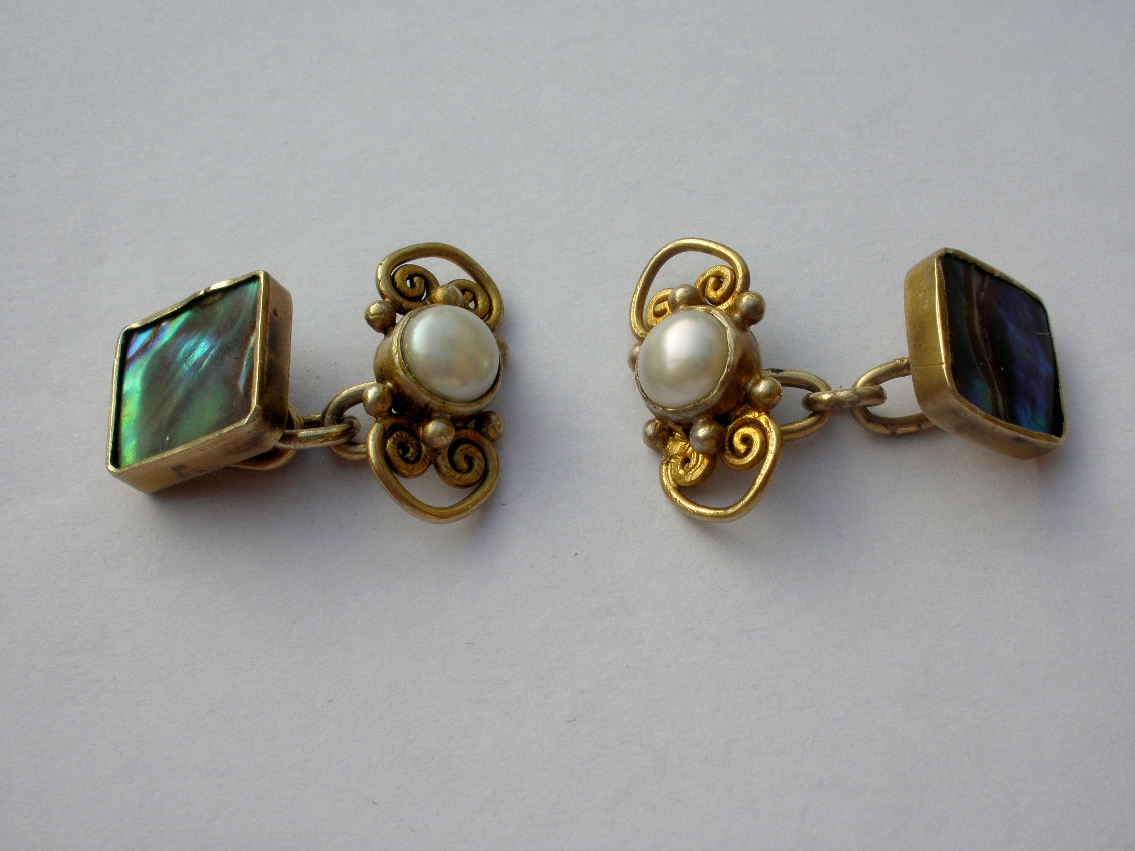 Mary Thew, Arts and Crafts pair of cultured pearl and abalone shell cuff links, Scotland, circa 1920, unmarked, the abalone shell panel 10 mm square