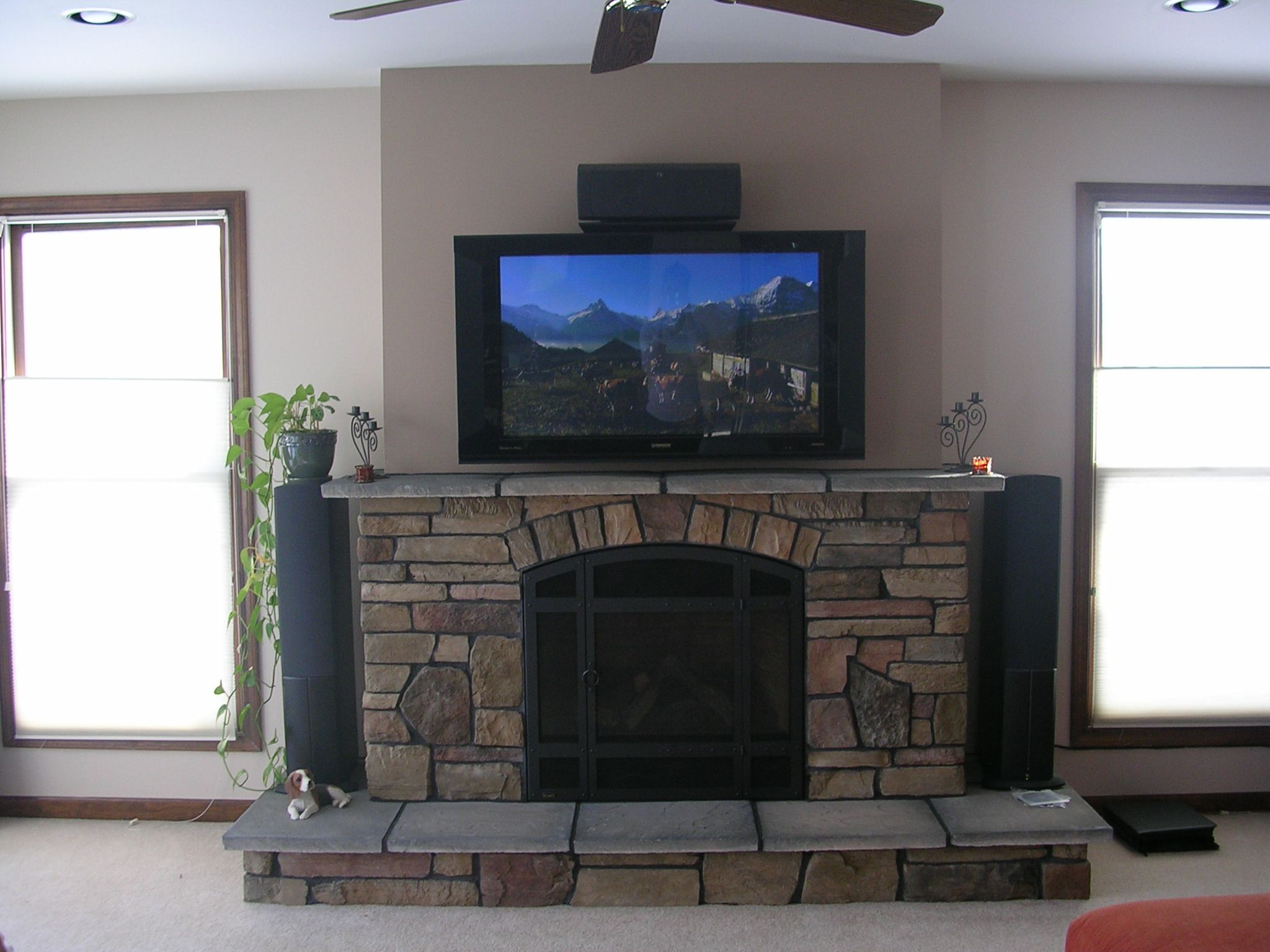 flat panel tv over fireplace of fireplace and cabinet regency