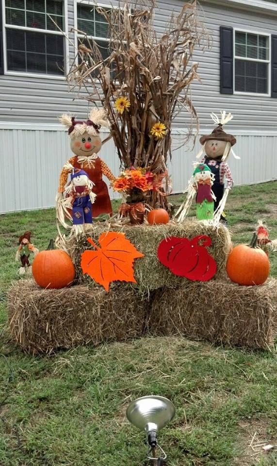 Outside fall decor corn stalks hay fodder shock fall for Pictures of fall decorations for the yard