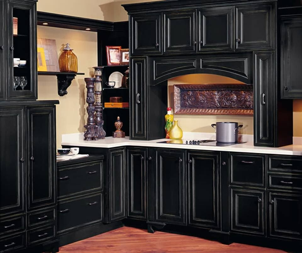 Depth Of Color And Style Speak Volumes In A Bold Kitchen With A Personality Of Its Own These Stained Kitchen Cabinets Decora Cabinets Kitchen Cabinet Hardware
