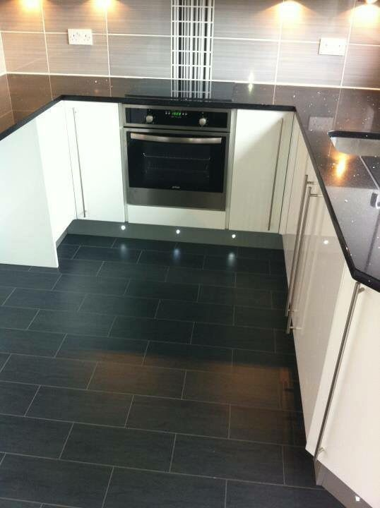 Black granite worktop, grey and black tiles & white gloss units ...